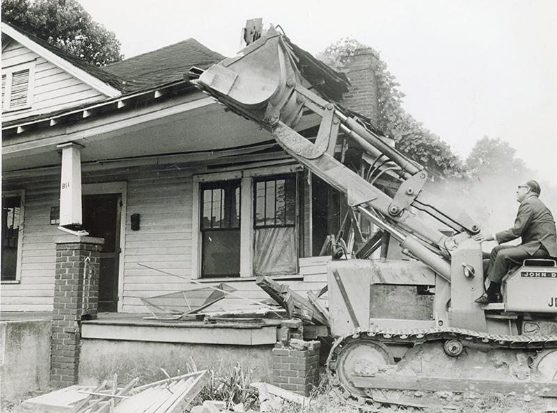 Bulldozer Demolishes House For Urban Renewal