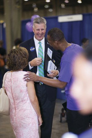 Lassiter greets voters at Park Fest, an event held in August at the Park Conference and Expo Center, formerly the Merchandise Mart.