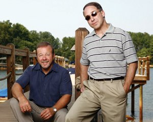"Business partners Lou Amico, left, and Joe Zammit often hold meetings with clients on Lake Norman. - <em>Mike Hammer</em>"" border=""0″></p> <p class="